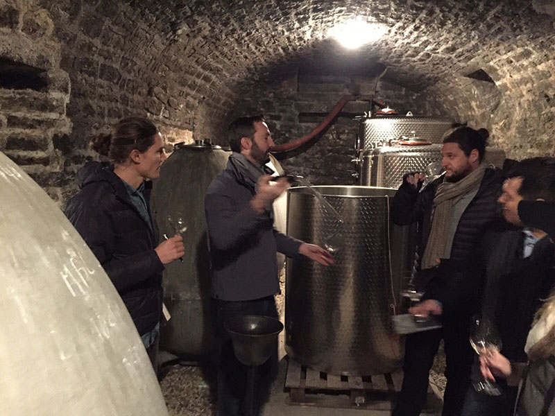 Seth at a Dujac wine cave with the Seysses family